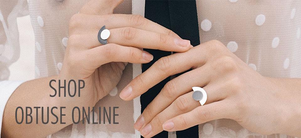 Hands wearing Obtuse Jewellery